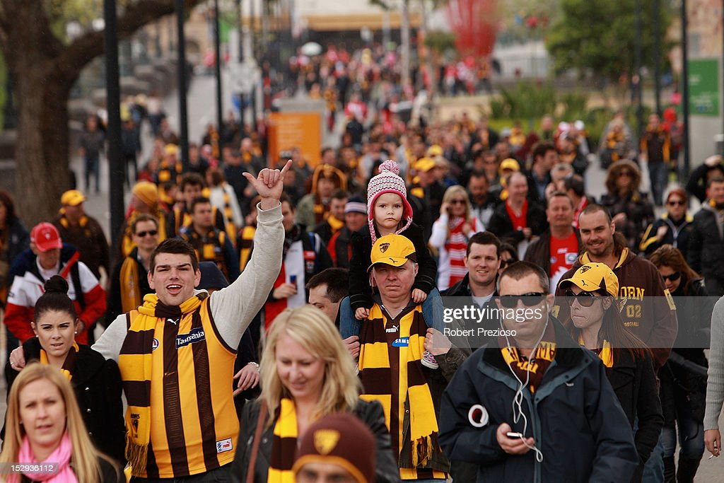Fans walk along Birrarung Marr making their way to the 2012 AFL Grand Final match between the Sydney Swans and the Hawthorn Hawks at the Melbourne...
