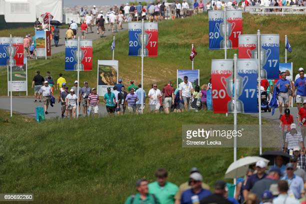 Fans walk along the course during a practice round prior to the 2017 US Open at Erin Hills on June 13 2017 in Hartford Wisconsin