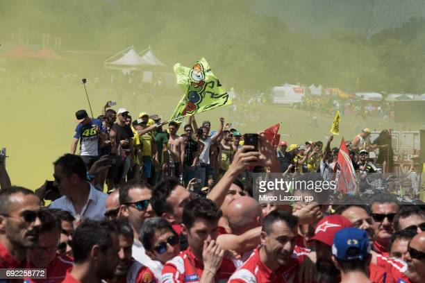 Fans walk and celebrate on track at the end of the MotoGP race during the MotoGp of Italy Race at Mugello Circuit on June 4 2017 in Scarperia Italy