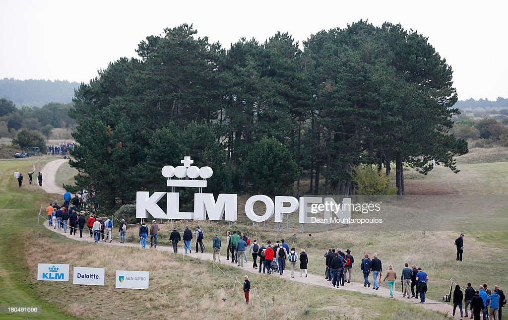 Fans walk between the the 1st and 9th hole past the giant sign during Day 2 of the KLM Open at Kennemer G & CC on September 13, 2013 in Zandvoort, Netherlands.