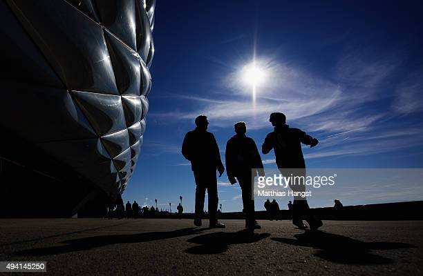 Fans walk by the Allianz Arena prior to the Bundesliga match between FC Bayern Muenchen and 1 FC Koeln at Allianz Arena on October 24 2015 in Munich...