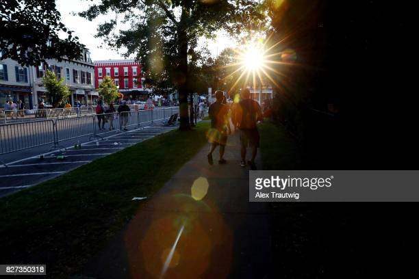 Fans walk down Main St following the 2017 Hall of Fame Parade of Legends at the National Baseball Hall of Fame on Saturday July 29 2017 in...