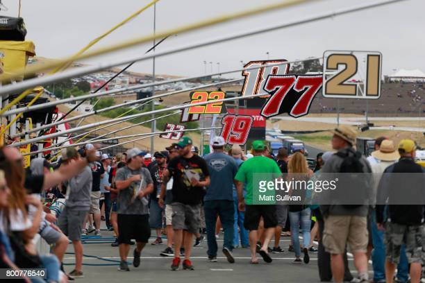 Fans walk down pit road prior to the start of the Monster Energy NASCAR Cup Series Toyota/Save Mart 350 at Sonoma Raceway on June 25 2017 in Sonoma...