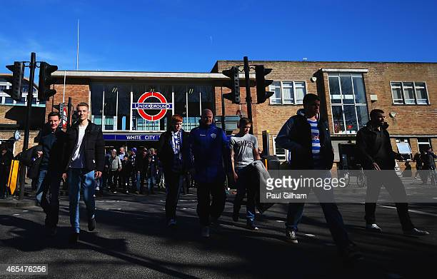 Fans walk from White City station prior to the Barclays Premier League match between Queens Park Rangers and Tottenham Hotspur at Loftus Road on...