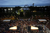 Fans walk into Arthur Ashe Stadium for the night session with the Unisphere behind them during Day Eleven of the 2011 US Open at the USTA Billie Jean...