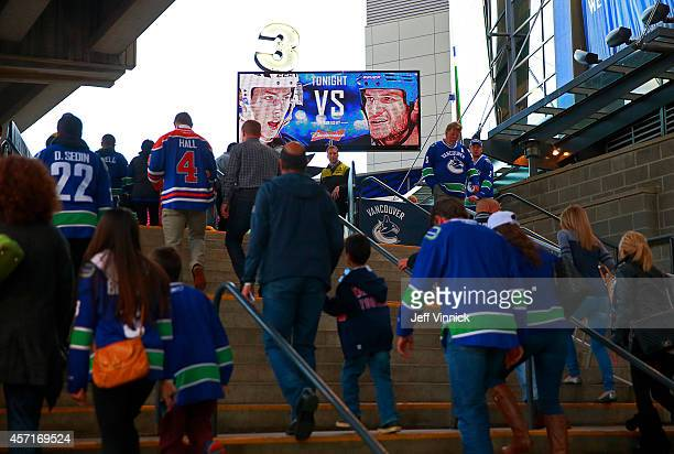 Fans walk into Rogers Arena before the game between the the Vancouver Canucks and the Edmonton Oilers October 11 2014 in Vancouver British Columbia...