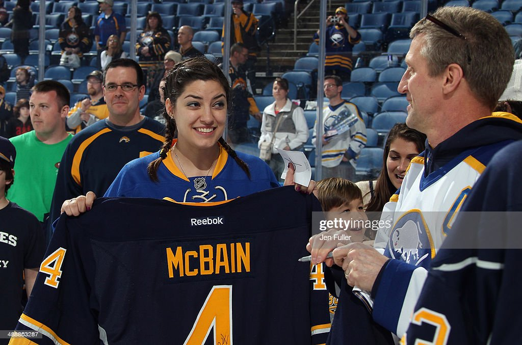Fans walk off the ice following the Jersey 'Off My Back' celebration by the Buffalo Sabres after a game against the New York Islanders at First Niagara Center on April 13, 2014 in Buffalo, New York.