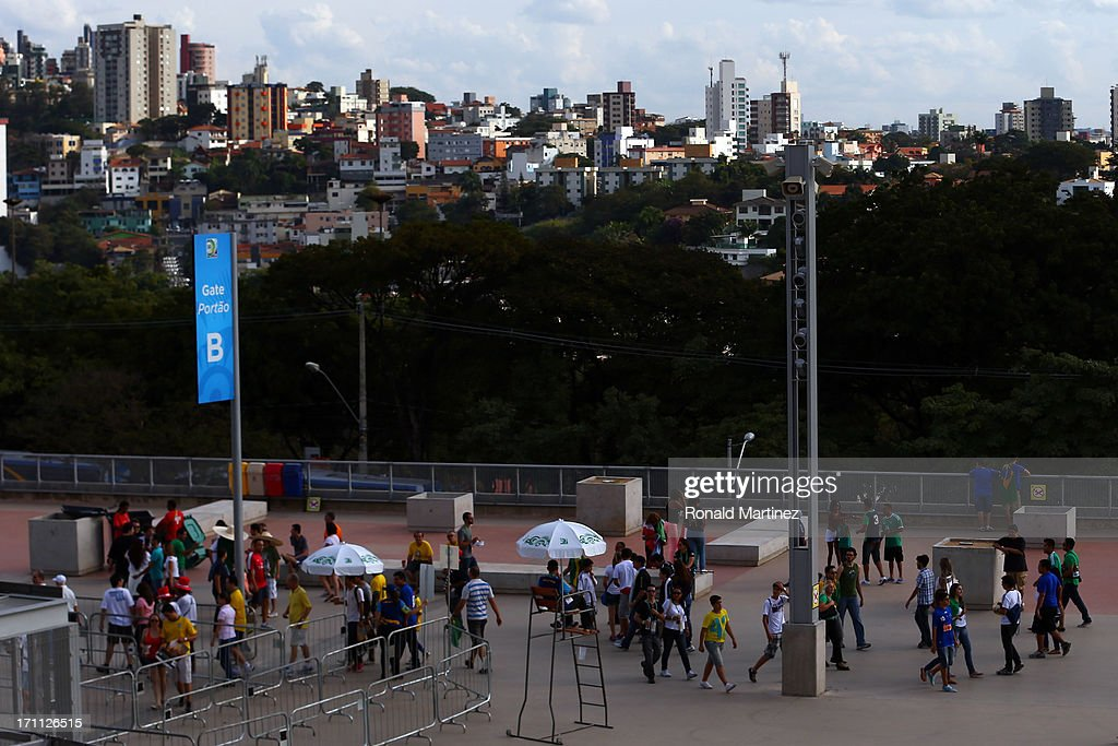 Fans walk outside of the stadium prior to the FIFA Confederations Cup Brazil 2013 Group A match between Japan and Mexico at Estadio Mineirao on June...