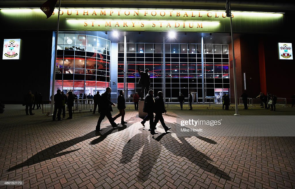 Fans walk outside the ground prior to the Barclays Premier League match between Southampton and Manchester United at St Mary's Stadium on December 8...