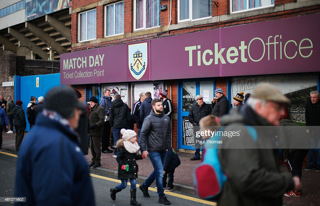 Fans walk outside the ground prior to the Barclays Premier League match between Burnley and Queens Park Rangers at Turf Moor on January 10 2015 in...
