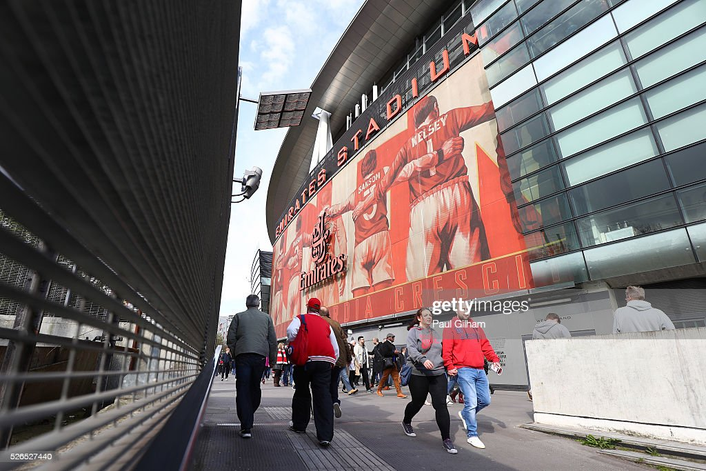 Fans walk outside the ground prior to the Barclays Premier League match between Arsenal and Norwich City at The Emirates Stadium on April 30, 2016 in London, England