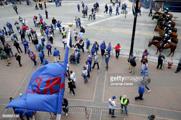 Fans walk outside the stadium as mounted police block Clark St before game four of the National League Division Series between the Washington...