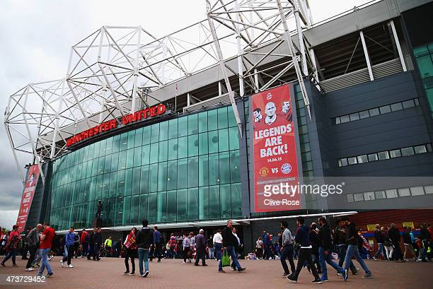 Fans walk outside the stadium prior to the Barclays Premier League match between Manchester United and Arsenal at Old Trafford on May 17 2015 in...