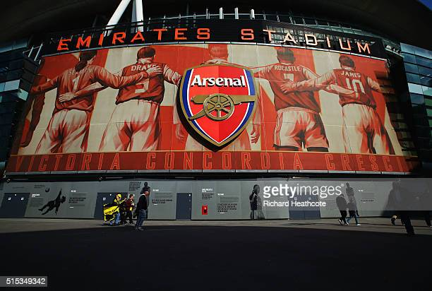 Fans walk outside the stadium prior to the Emirates FA Cup sixth round match between Arsenal and Watford at Emirates Stadium on March 13 2016 in...
