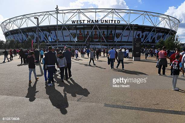 Fans walk outside the stadium prior to the Premier League match between West Ham United and Southampton at London Stadium on September 25 2016 in...