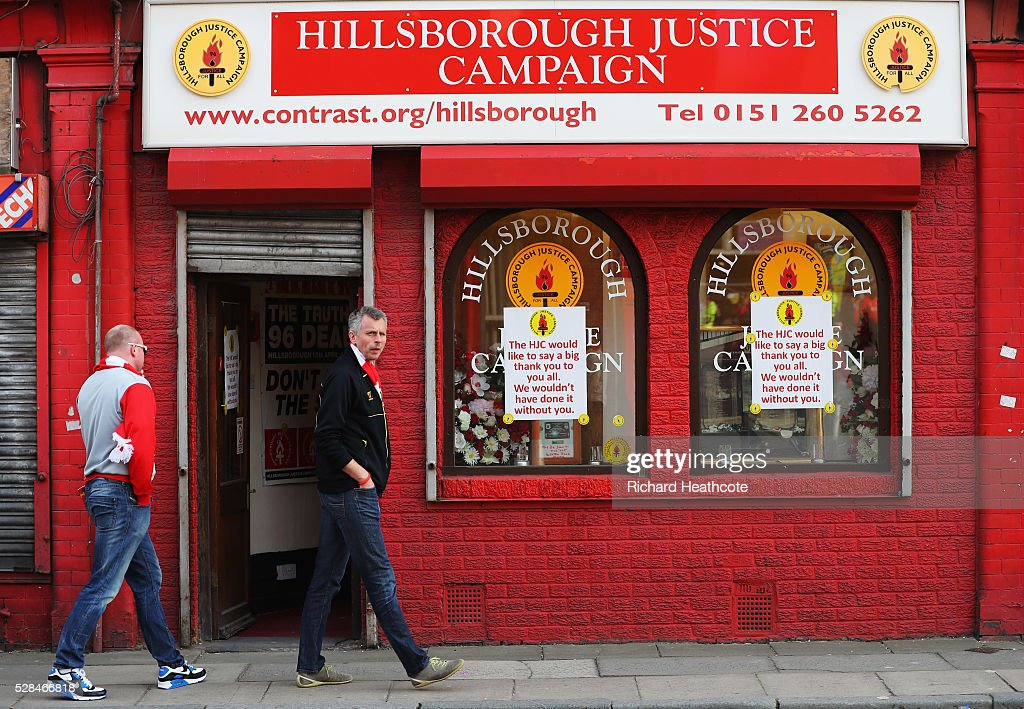 Fans walk past a Hillsborough Justice Campaign office prior to the UEFA Europa League semi final second leg match between Liverpool and Villarreal CF at Anfield on May 5, 2016 in Liverpool, England.