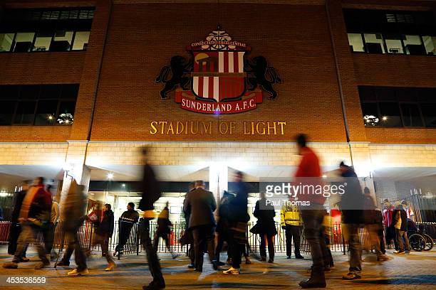 Fans walk past the Sunderland badge before the Barclays Premier League match between Sunderland and Chelsea at the Stadium of Light on December 4...