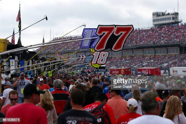 Fans walk pit road before the Monster Energy NASCAR Cup Series Alabama 500 at Talladega Superspeedway on October 15 2017 in Talladega Alabama