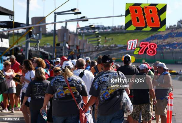 Fans walk the grid before the Monster Energy NASCAR Cup Series Quaker State 400 presented by Advance Auto Parts at Kentucky Speedway on July 8 2017...