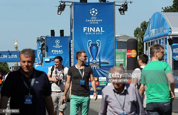 Fans walk through the UEFA Champions Festival on its opening day in Berlin on June 4 2015 two days before the final AFP PHOTO / ADAM BERRY