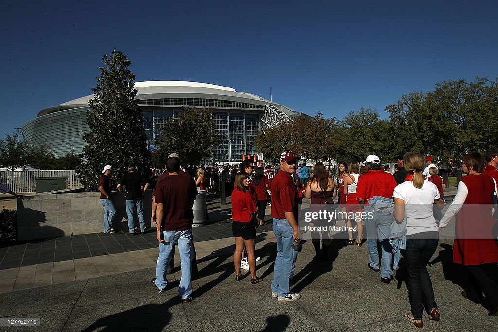 Fans walk to Cowboys Stadium before a game between the Texas A&M Aggies and the Arkansas Razorbacks on October 1, 2011 in Arlington, Texas.