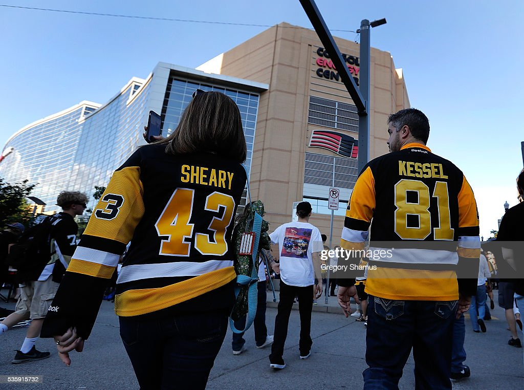 Fans walk to the arena prior to Game One of the 2016 NHL Stanley Cup Final between the San Jose Sharks and the Pittsburgh Penguins at Consol Energy Center on May 30, 2016 in Pittsburgh, Pennsylvania.