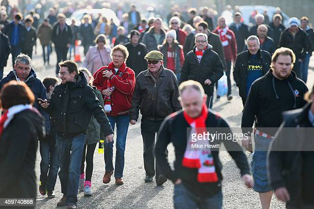 Fans walk to the ground prior to the Barclays Premier League match between Southampton and Manchester City at St Mary's Stadium on November 30 2014...