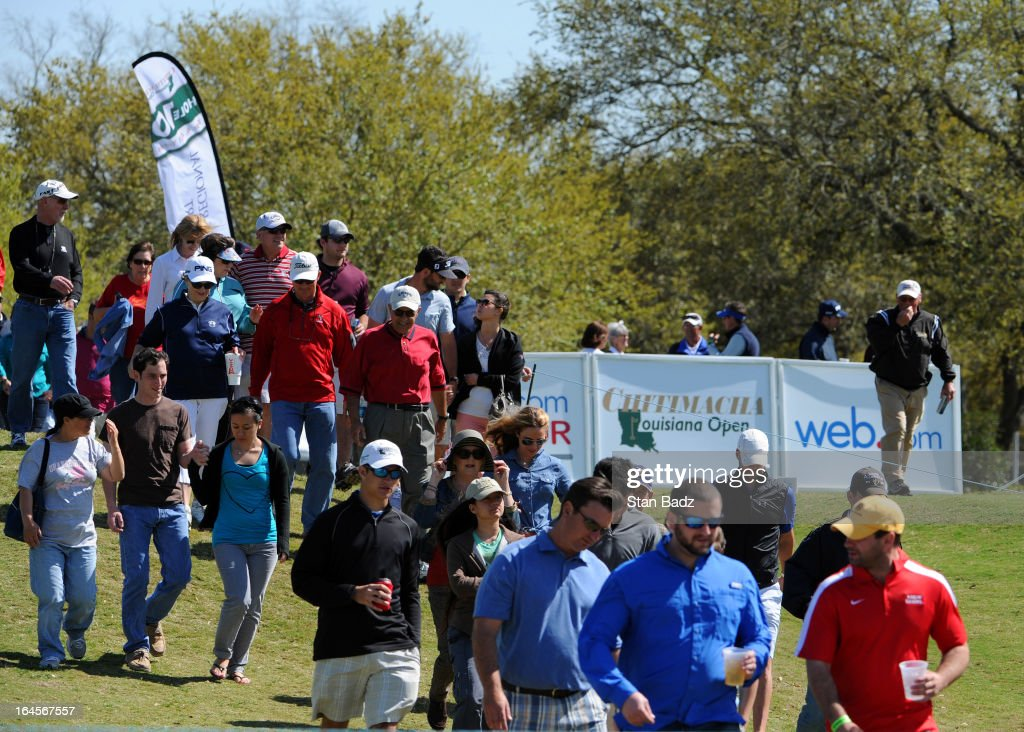 Fans walk to the tenth hole during the final round of the Chitimacha Louisiana Open at Le Triomphe Country Club on March 24, 2013 in Broussard, Louisiana.