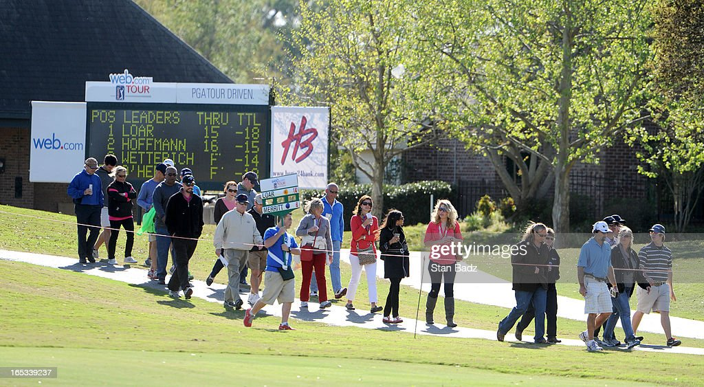 Fans walk to the16th hole during the final round of the Chitimacha Louisiana Open at Le Triomphe Country Club on March 24, 2013 in Broussard, Louisiana.