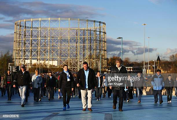 Fans walk towards the ground prior to the Barclays Premier League match between Manchester City and Swansea City at Etihad Stadium on November 22...