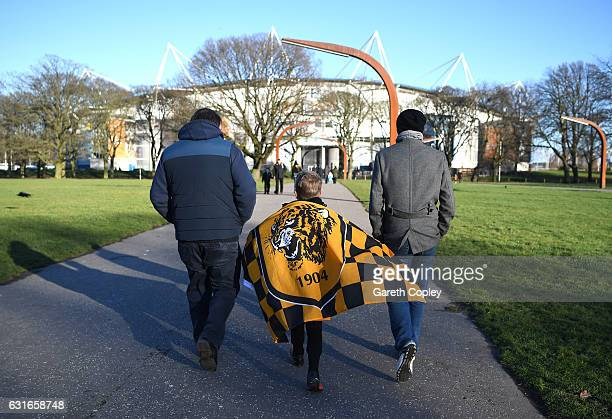 Fans walk towards the ground prior to the Premier League match between Hull City and AFC Bournemouth at KCOM Stadium on January 14 2017 in Hull...