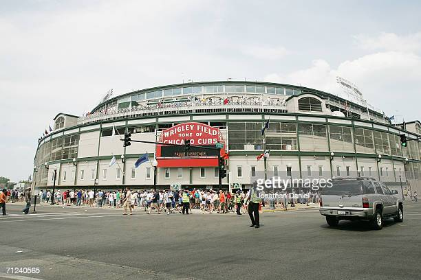 Fans walk up to Wrigley Field before the Chicago Cubs game against the Detroit Tigers on June 17 2006 at Wrigley Field in Chicago Illinois The Tigers...