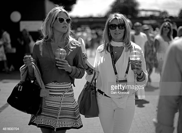 Fans walking around Wimbledon Tennis drinking pimms on day nine of the Wimbledon Lawn Tennis Championships at the All England Lawn Tennis and Croquet...