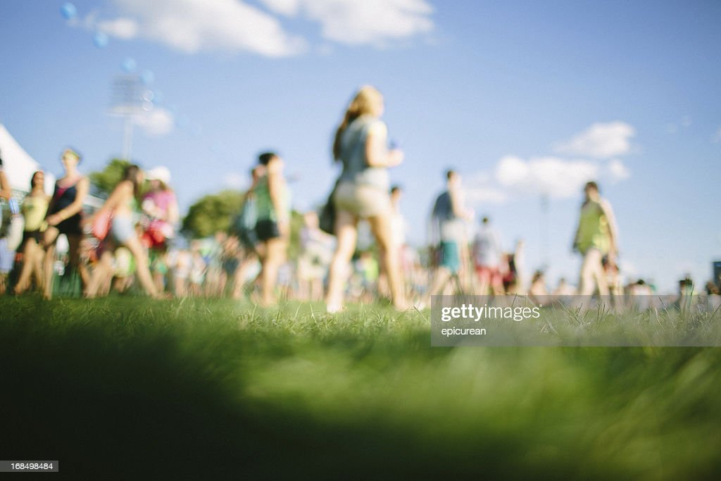 Fans walking at music festival : Stock Photo