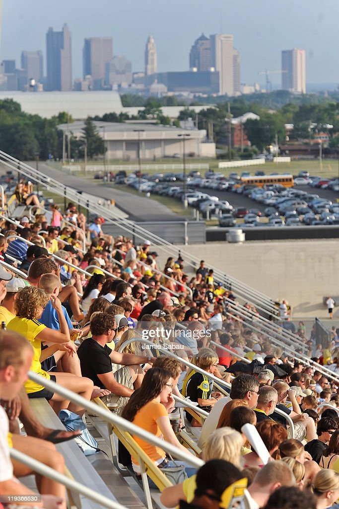Fans watch a game between the Columbus Crew and the San Jose Earthquakes with the skyline of the city of Columbus in the background on July 16 2011...