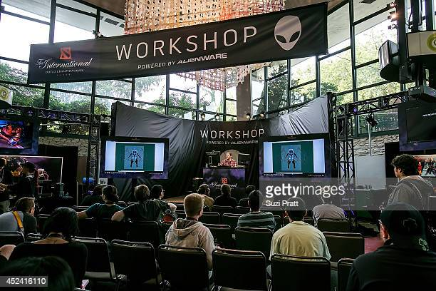 Fans watch a graphic design demostration at The International DOTA 2 Champsionships at Key Arena on July 19 2014 in Seattle Washington
