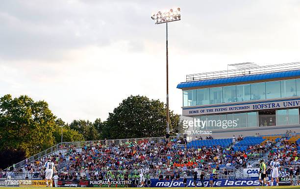 Fans watch a Major League Lacrosse game between the New York Lizards and the Ohio Machine at Shuart Stadium on August 10 2013 in Uniondale New York...