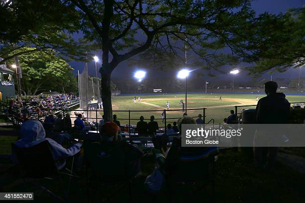 Fans watch a night game under the lights where the Brewster Whitecaps faced the Chatham Anglers at Veterans Field