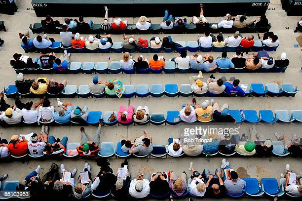 Fans watch a spring training game between the New York Mets and the Baltimore Orioles at Fort Lauderdale Stadium on February 25 2008 in Fort...