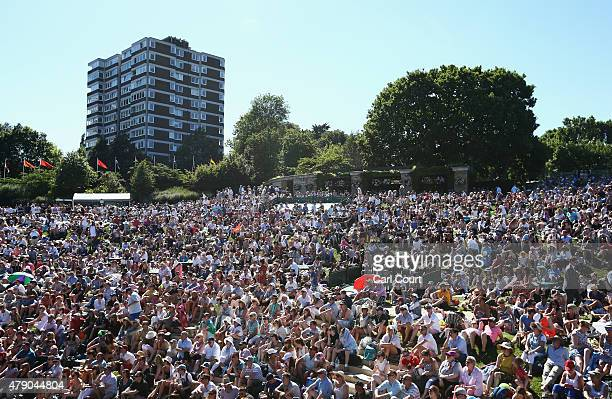 Fans watch Andy Murray of Great Britain play in his Gentlemens Singles first round match against Mikhail Kukushkin of Kazakhstan on Murray Mound...