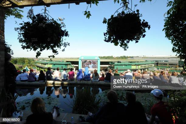 Fans watch Andy Murray's match against USA's Robert Kendrick from Murray Mount during the 2009 Wimbledon Championships at the All England Lawn Tennis...
