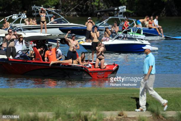 Fans watch as Bill Haas walks to the 14th hole during round five of the World Golf ChampionshipsDell Technologies Match Play at the Austin Country...