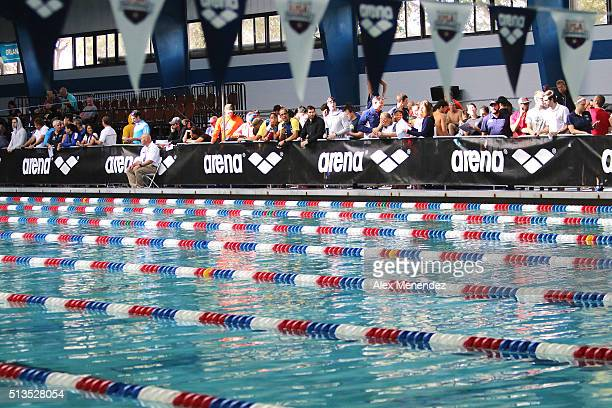 Fans watch as competitors swim during day one of the Arena Pro Swim Series at the YMCA of Central Florida Aquatic Center on March 3 2016 in Orlando...