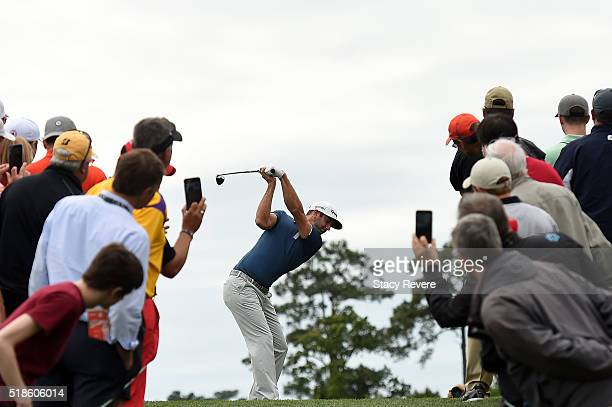 Fans watch as Dustin Johnson of the United States hits his tee shot on the third hole during the second round of the Shell Houston Open at the Golf...
