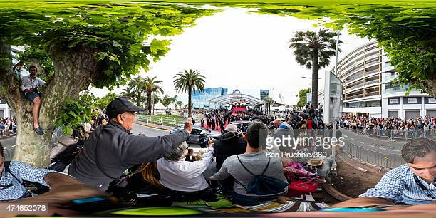 Fans watch as guests arrive for the closing ceremony and 'Le Glace Et Le Ciel' Premiere during the 68th annual Cannes Film Festival on May 24 2015 in...