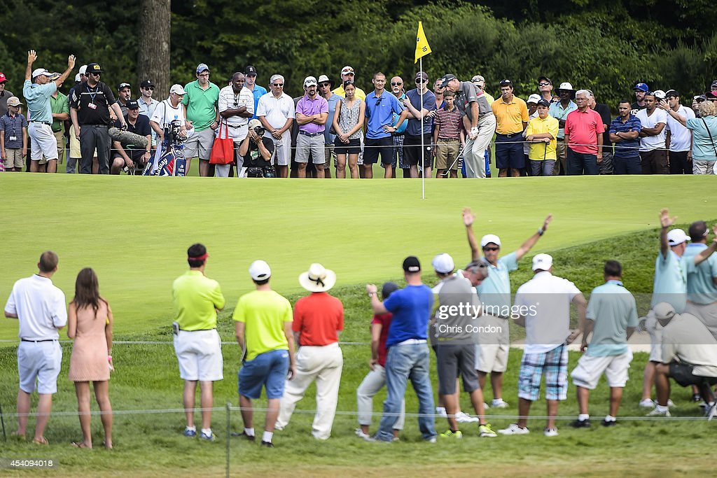 Fans watch as Jim Furyk chips his onto the 10th hole green during the final round of The Barclays at Ridgewood Country Club on August 24, 2014 in Paramus, New Jersey.