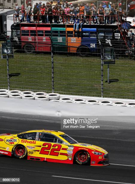 NASCAR fans watch as Joey Logano races through turn one during the O'Reilly Auto Parts 500 on Sunday April 9 2017 at Texas Motor Speedway in Fort...
