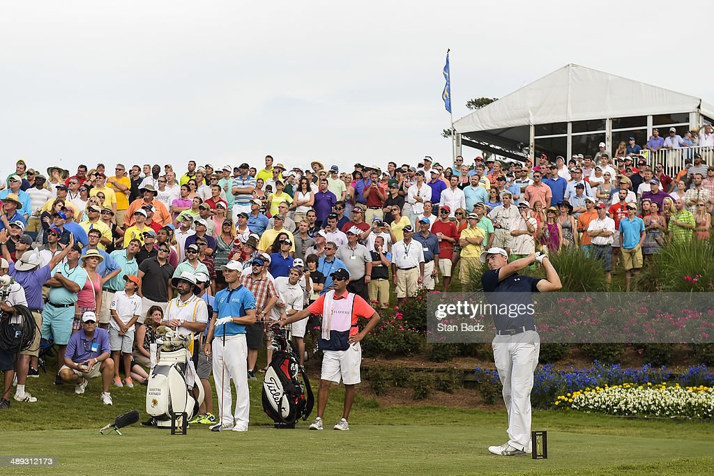 Fans watch as Jordan Spieth tees off on the 18th hole during the third round of THE PLAYERS Championship on THE PLAYERS Stadium Course at TPC Sawgrass on May 10, 2014 in Ponte Vedra Beach, Florida.