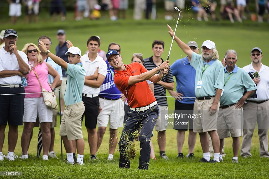 Fans watch as Martin Kaymer of Germany chips a shot from the rough on the 10th hole during the second round of The Barclays at Ridgewood Country Club on August 22, 2014 in Paramus, New Jersey.