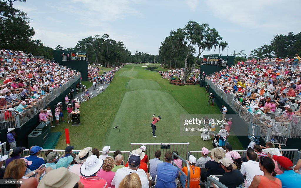 Fans watch as Martin Kaymer of Germany hits his tee shot on the first hole during the final round of THE PLAYERS Championship on The Stadium Course...
